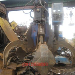 Погрузчик металлолома FUCHS MHL 340 c грейфером SCE 605