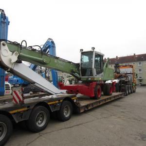 Транспортировка перегружателя Fuchs MHL 331 из Германии